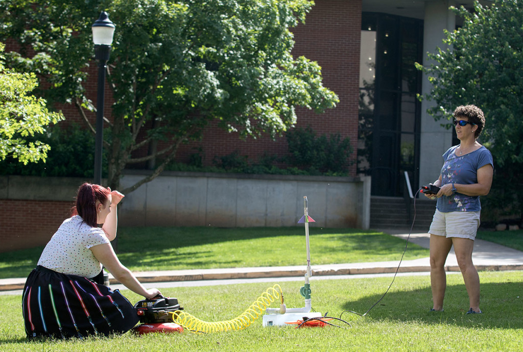 Emily McKernan, from Dickinson Center, N.Y., tests her rocket on Tuesday, June 6. The rockets were made from paper, tape, and foam. (Photo by Brook Joyner)