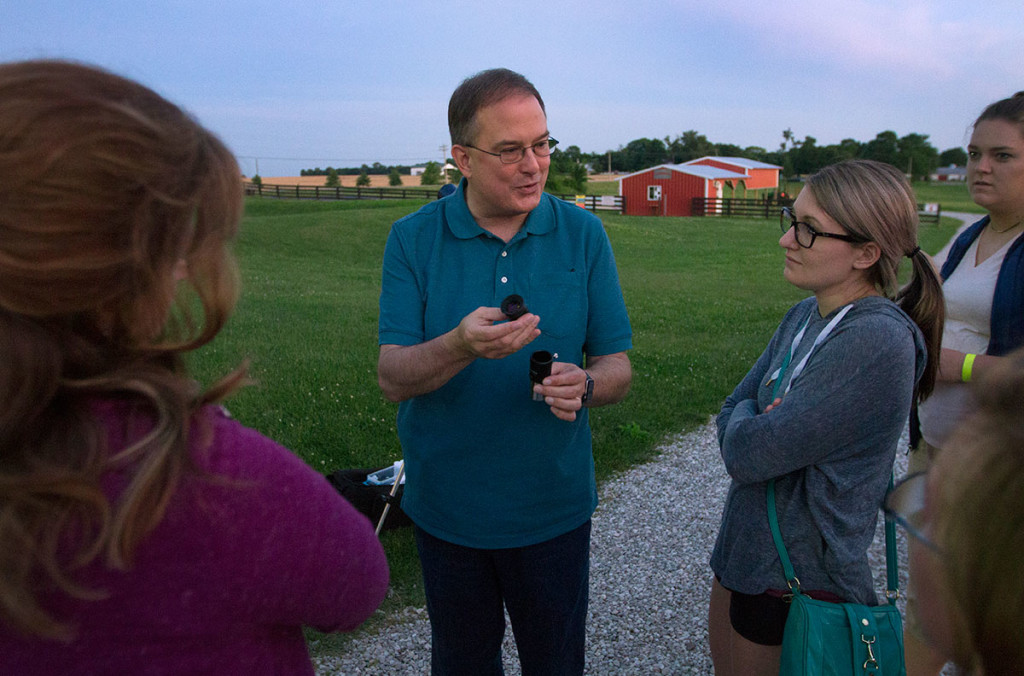 SKyTeach master teacher Rico Tyler explains telescope eyepieces to the NSCF Scholars before setting up a telescope for the scholars to use after sunset at Chaney's Dairy Barn outside Bowling Green Tuesday, June 6. Rico has taught physical science lessons to the scholars throughout the week. (Photo by Sam Oldenburg)